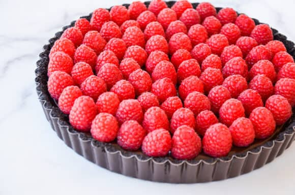 Fresh raspberries atop chocolate tart