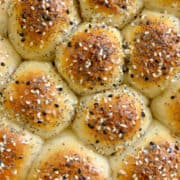 Closeup view of bagel pull-apart bread topped with everything seasoning with title underneath