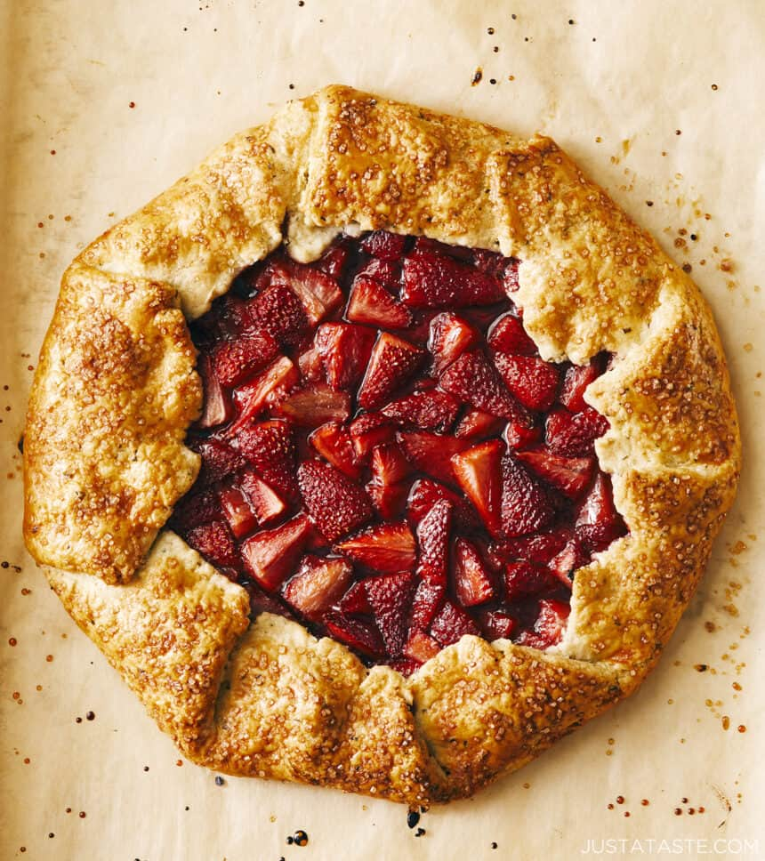 A top-down view of a Strawberry Galette on top of brown parchment paper.