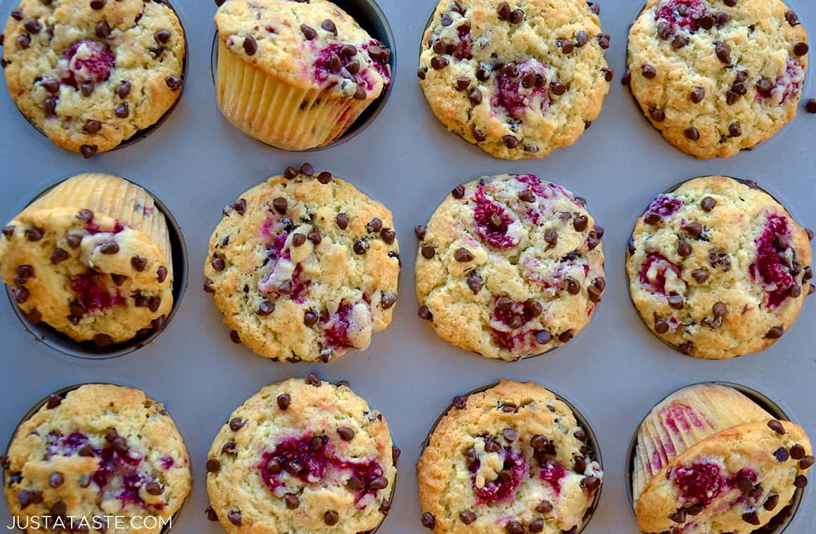 Muffins in a baking pan with raspberries and chocolate chips