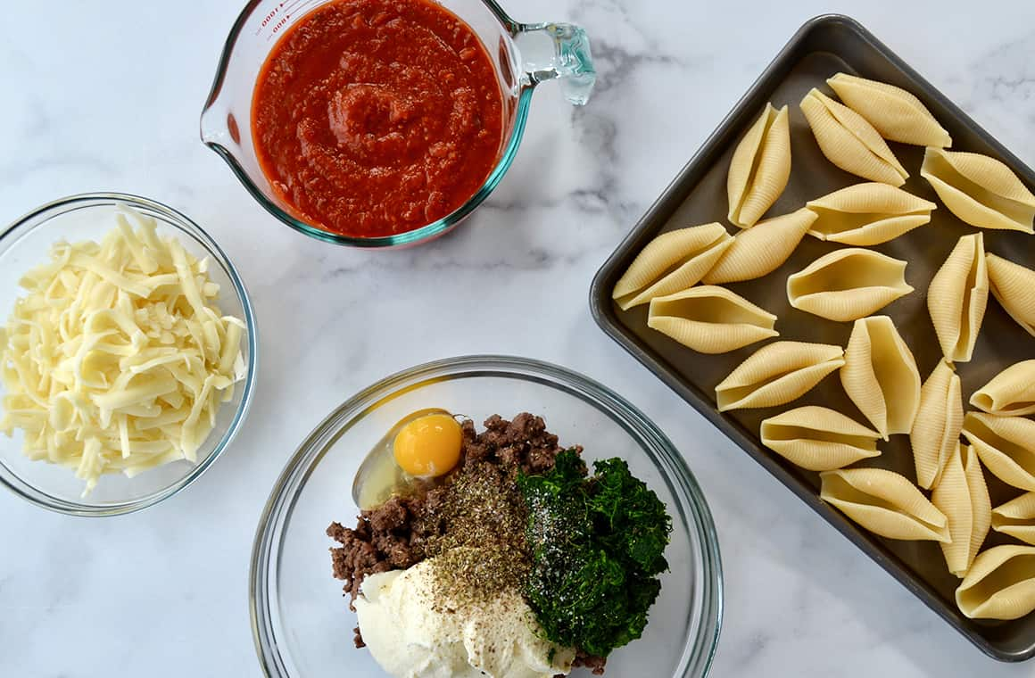 Ingredients for stuffed shells in glass bowls