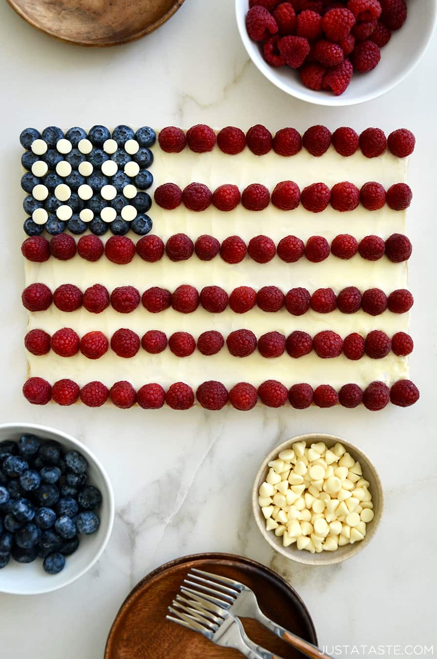 An American Flag Cookie Cake surrounded by bowls of berries