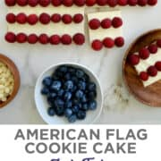 Top image: Top-down view of an American Flag Cookie Cake with two slices cut from the corner. Bottom image: An American Flag Cookie Cake with fresh raspberries and blueberries next to small bowls containing raspberries, blueberries and white chocolate chips.