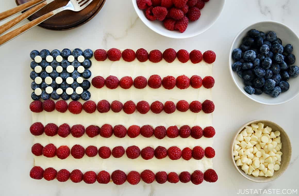 A cookie cake shaped like an American flag with berries