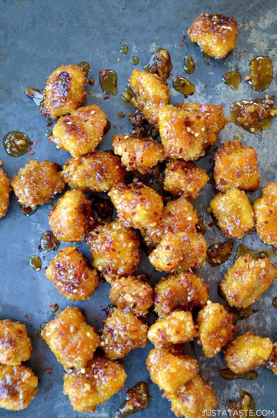 Baked Orange Chicken Poppers on a baking sheet