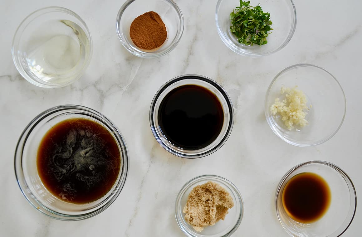 Glass bowls containing ingredients for steak marinade