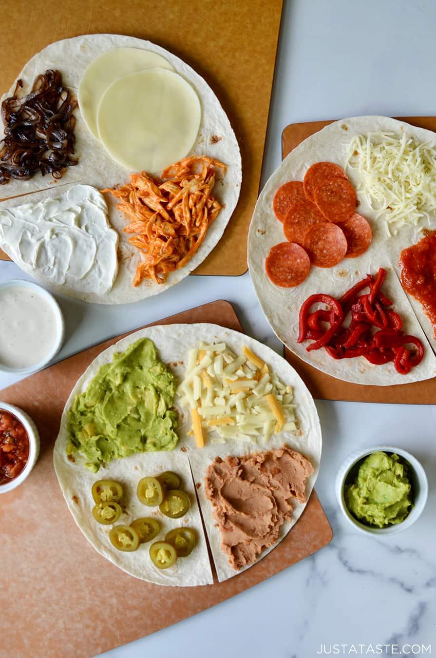 Open-faced nacho-inspired tortilla, buffalo chicken tortilla and pizza-style tortilla
