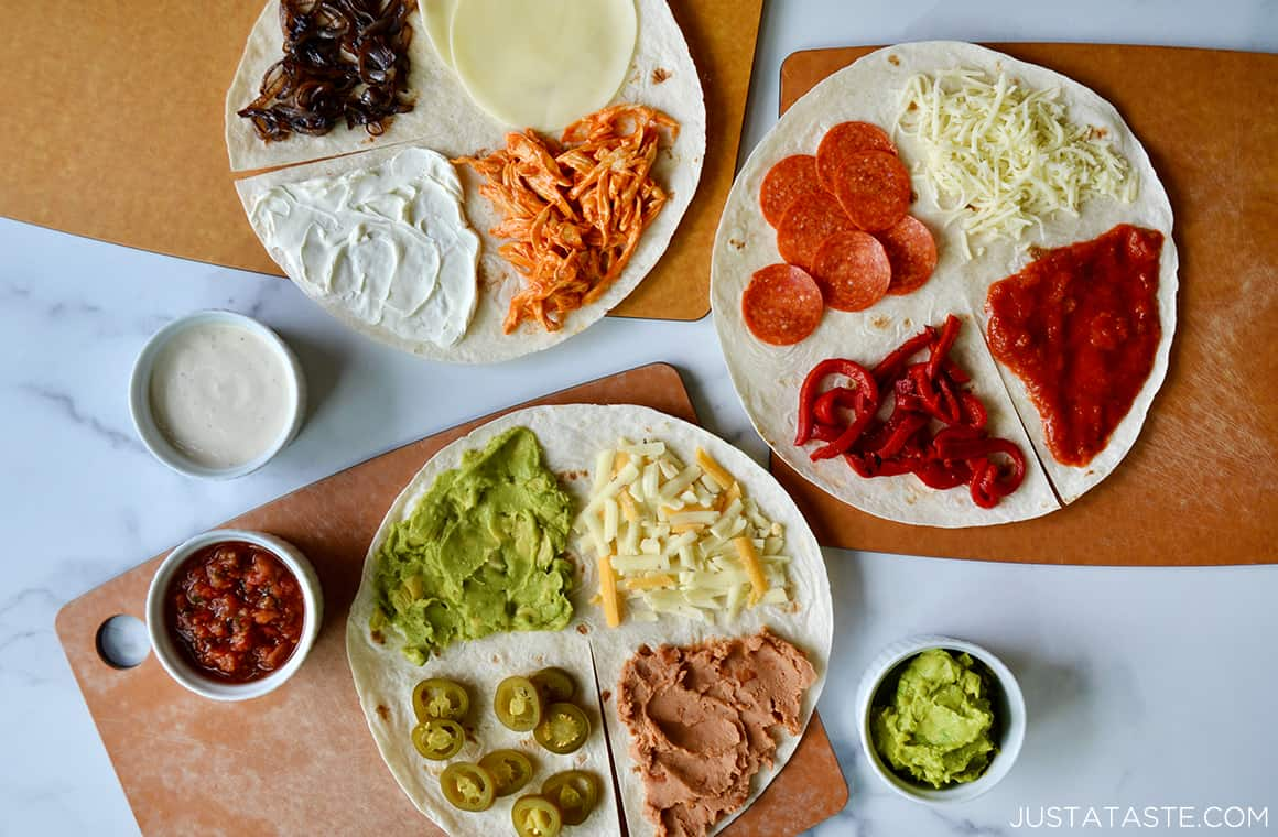 Three flour tortillas topped with various ingredients