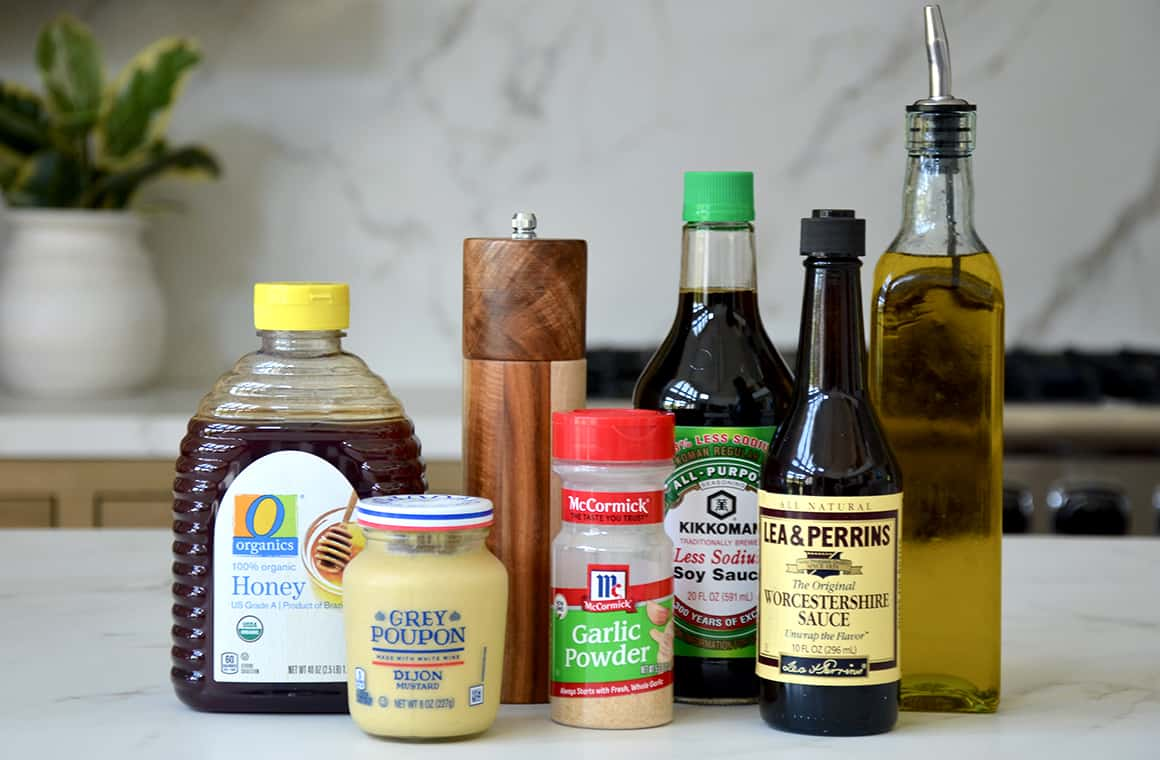 Marinade ingredients for tri-tip, including honey, Dijon mustard, garlic powder, soy sauce and Worcestershire sauce