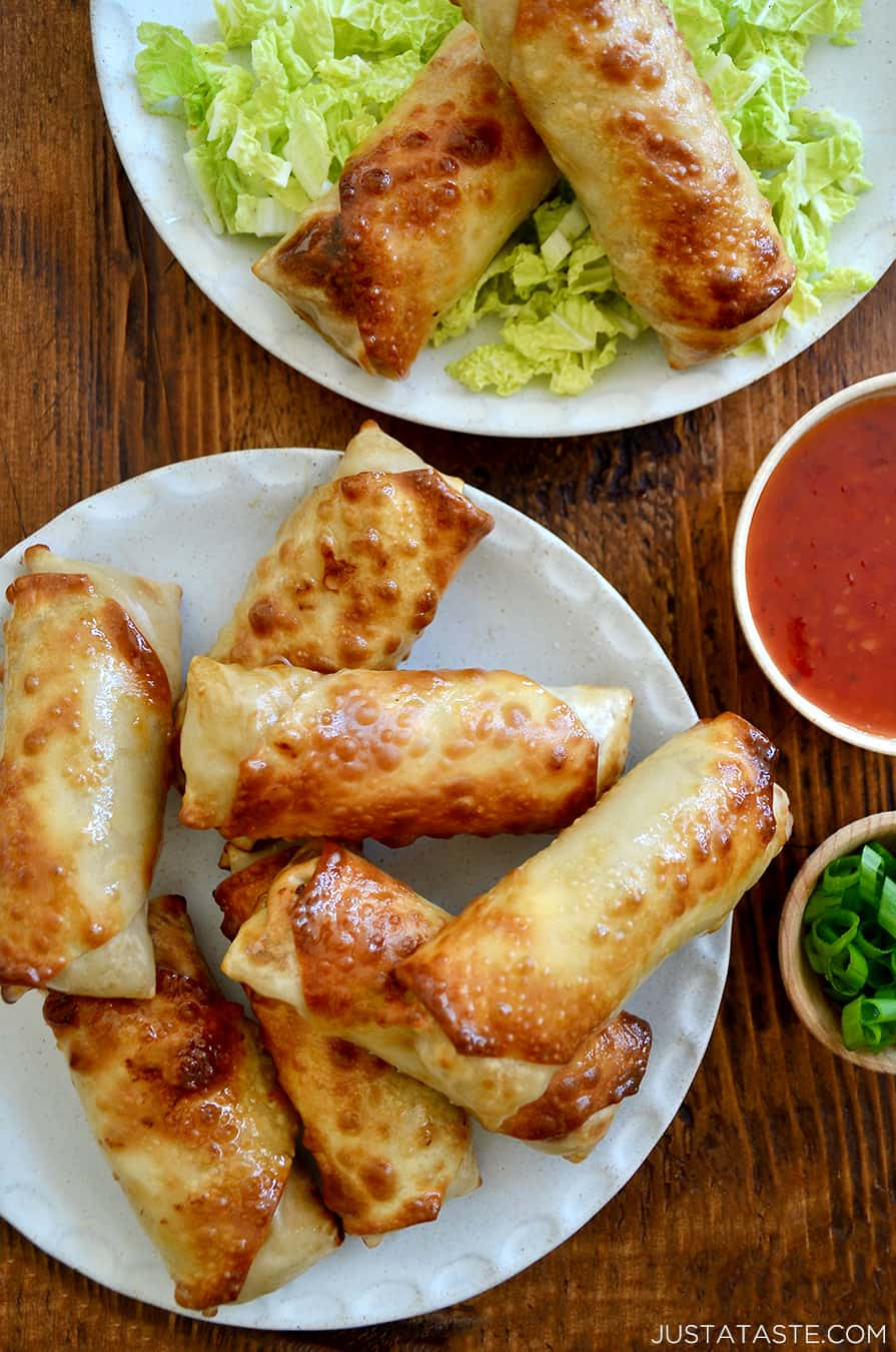 A top-down view of Air Fryer Egg Rolls on a white serving plate