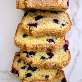 A top-down view of slices of Blueberry Orange Juice Bread