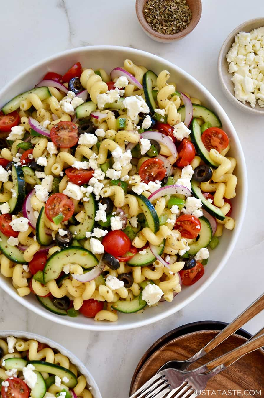 A bowl of Greek pasta salad topped with feta cheese
