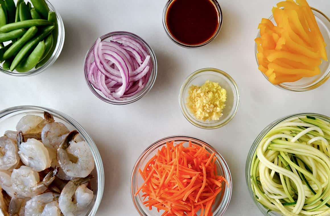 Glass bowls containing stir-fry ingredients