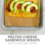 Top image: A top-down view of melted cheese topped with deli meat, lettuce, bacon, tomato and avocado atop a parchment paper-lined baking sheet. Bottom image: A Melted Cheese Sandwich Wrap.