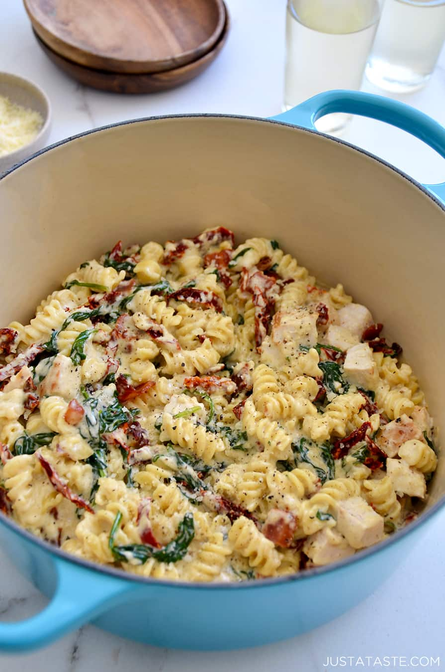A large light blue pot containing Creamy Tuscan Chicken Pasta