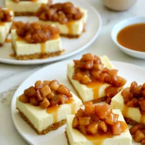 Two plates containing Easy Caramel Apple Cheesecake Bars