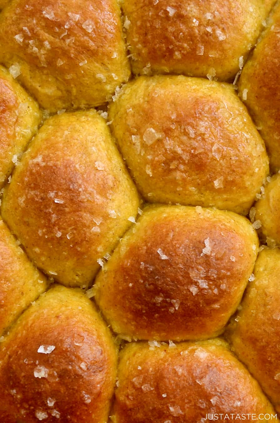 A close up of dinner rolls topped with sea salt