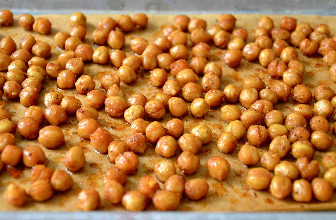 A baking sheet containing roasted chickpeas